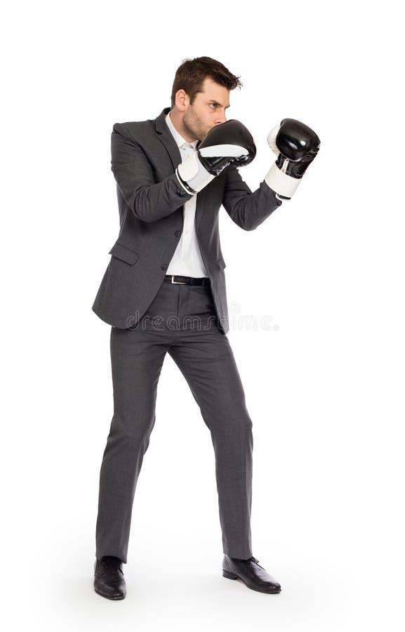 在拳击手套的商人 库存图片