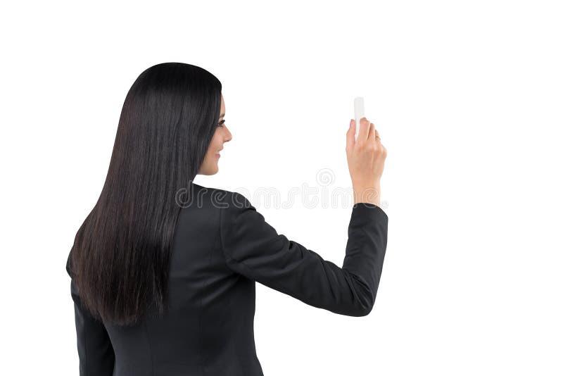 在拷贝空间写着某事一名深色的妇女的背面图 免版税库存图片