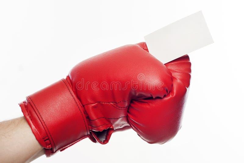 在拿着名片的拳击手套的手 库存照片