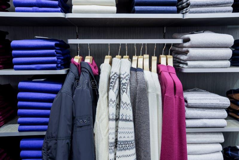 在挂衣架的衣物在商店 库存图片
