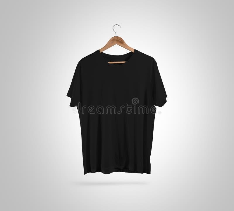 在挂衣架,设计大模型,裁减路线的空白的黑T恤杉前面 库存图片