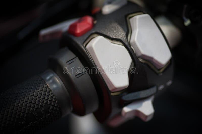 在摩托车的按钮 免版税库存照片