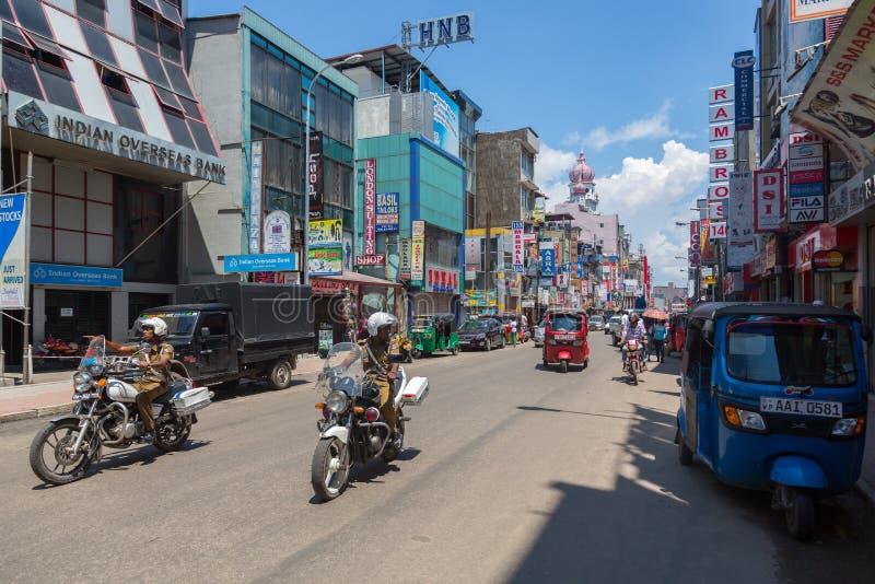 在摩托车的警察在Pettah地区街道在科伦坡,斯里兰卡 库存照片