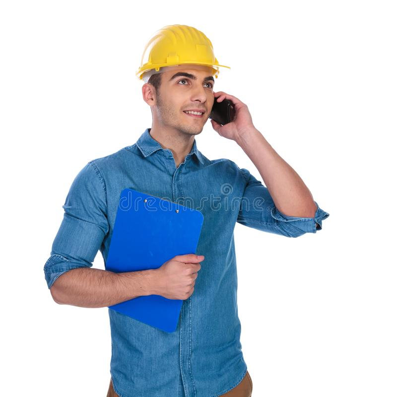 在支持的电话和查寻的工程师谈话 库存图片