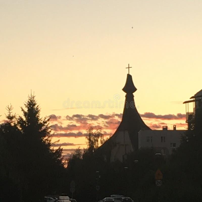 在教会的日落 免版税图库摄影