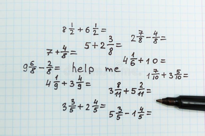 在数学的问题将帮助我 顶视图 免版税库存图片