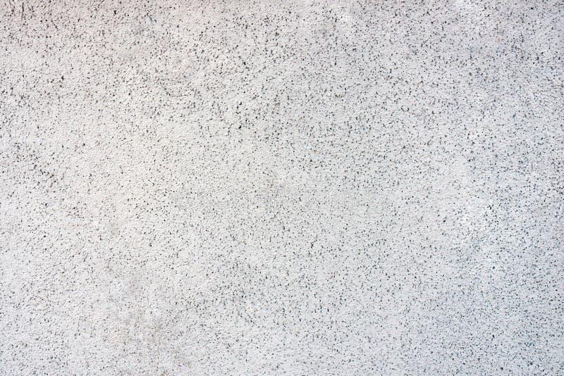 在斑点背景,纹理的白色墙壁 图库摄影