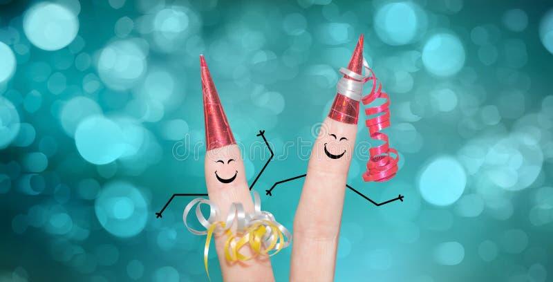 在新年` s伊芙的逗人喜爱的手指夫妇跳舞 免版税库存照片