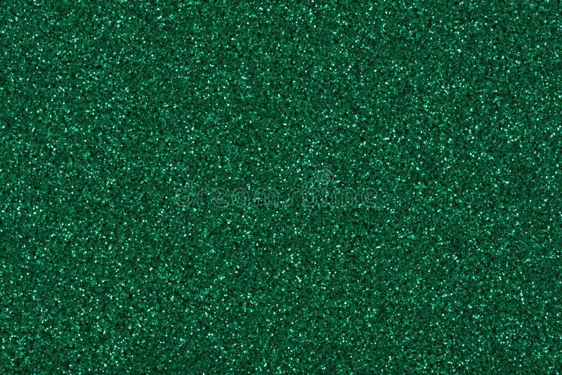 在新的绿色口气,您的圣诞节桌面的发光的纹理的闪烁背景 库存图片
