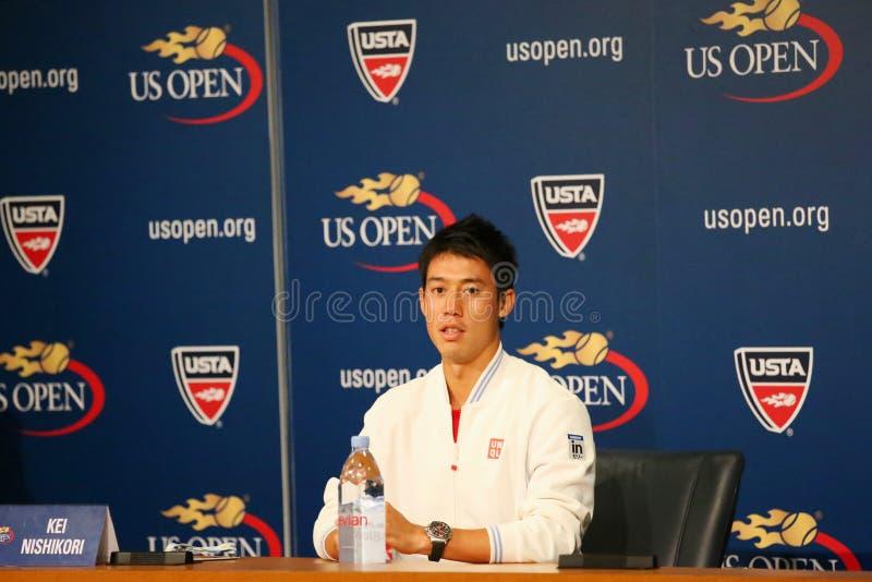 在新闻招待会期间的职业网球球员锦织圭,在他赢得了半决赛在美国公开赛2014年后 免版税库存图片