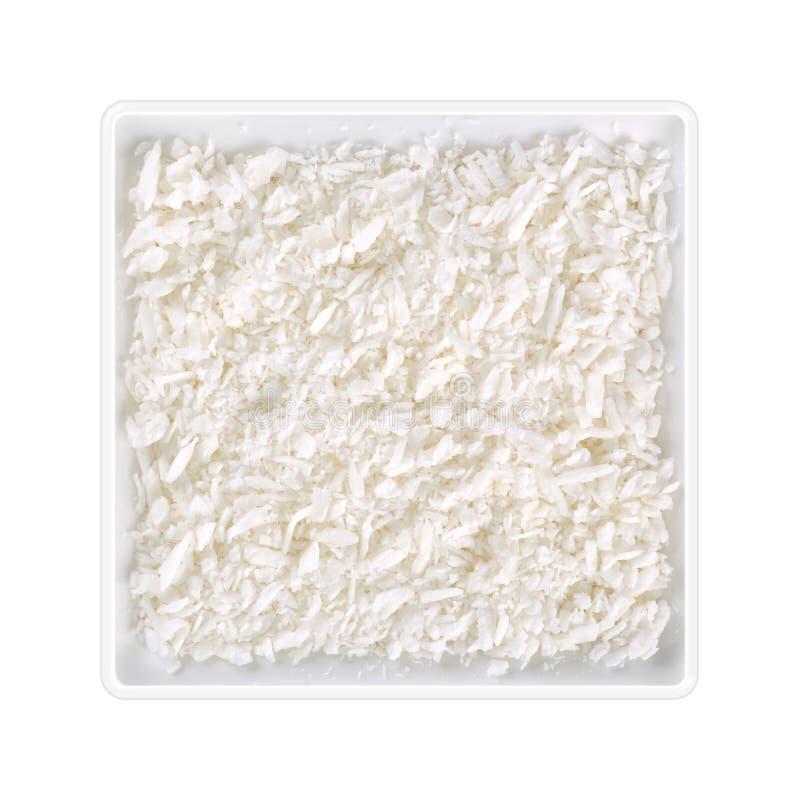 在方形的碗的椰子五谷在白色背景 免版税库存照片