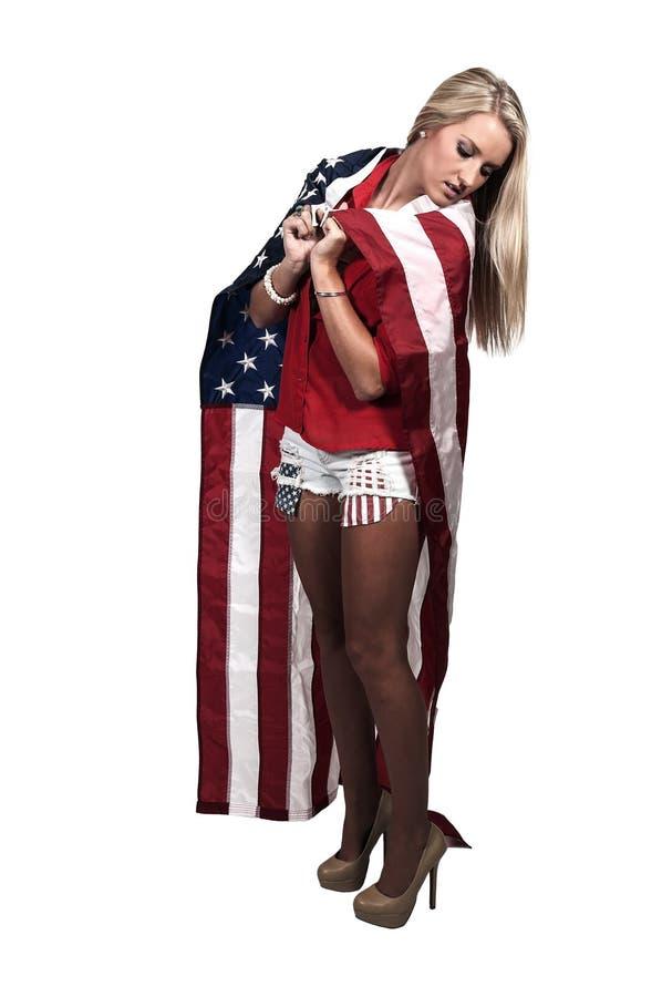 在旗子包裹的妇女 免版税图库摄影