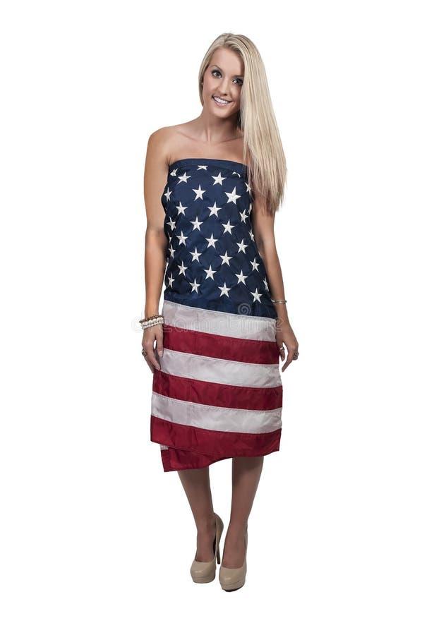 在旗子包裹的妇女 免版税库存图片