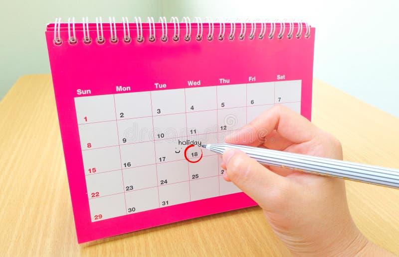 在日历的活动日期 库存照片