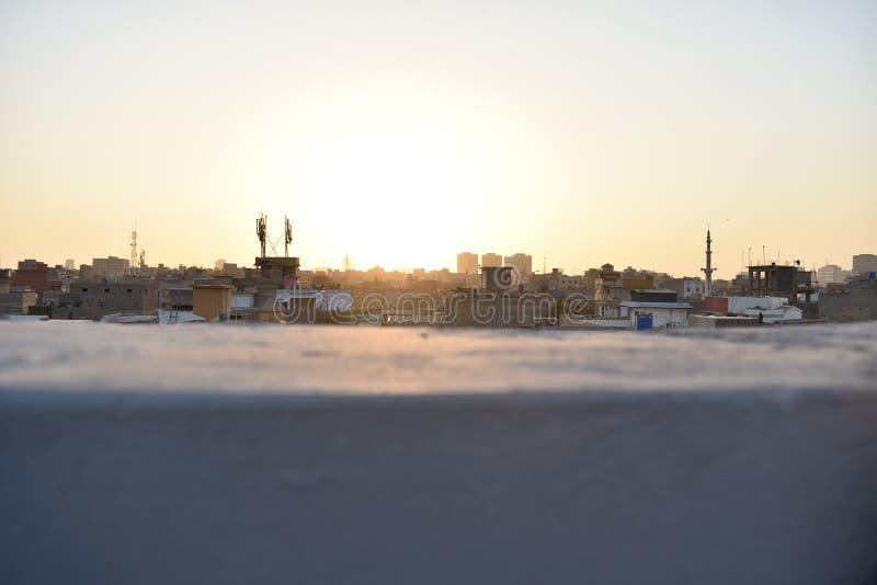 在日落时间的发光的太阳 图库摄影