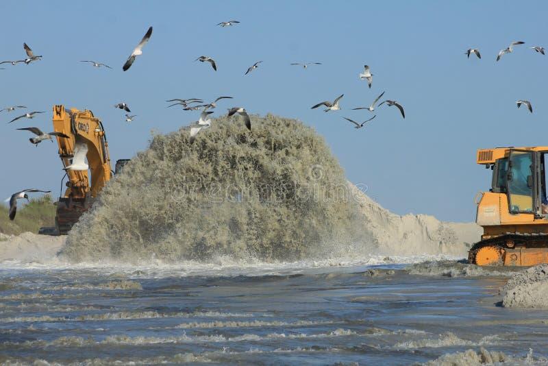 在日落海滩加注附近的墨西哥湾 免版税库存图片