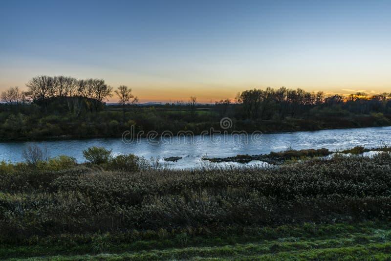 在日落的低地风景 库存图片