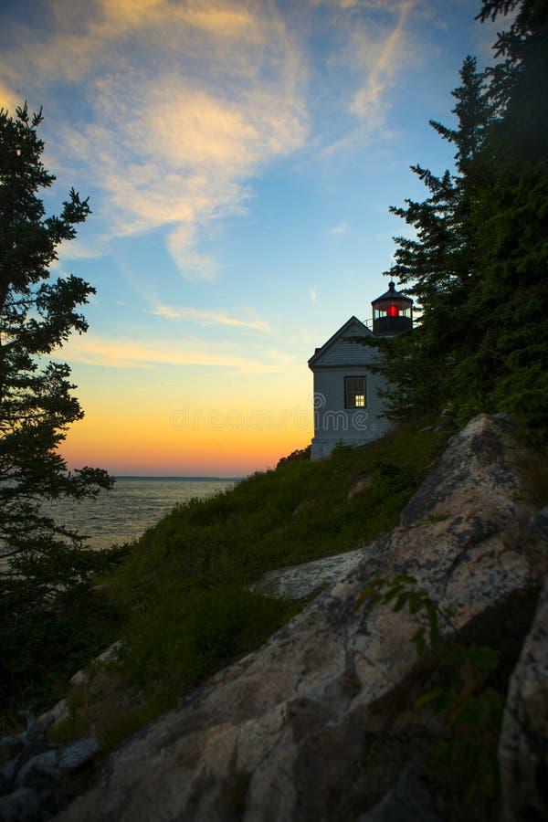 在日落的低音港口灯塔 免版税图库摄影
