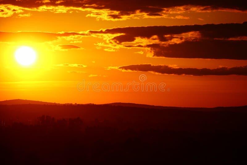 在日落的橙色太阳 库存照片