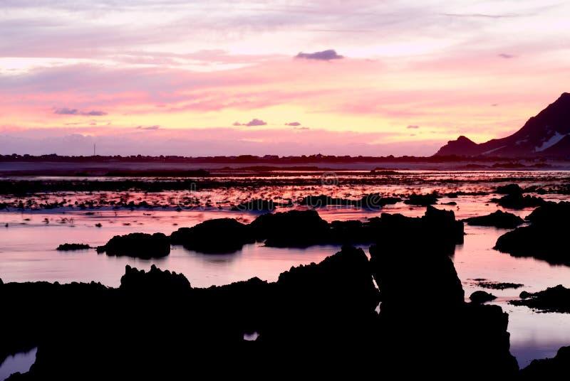 在日落的海洋横向 库存图片