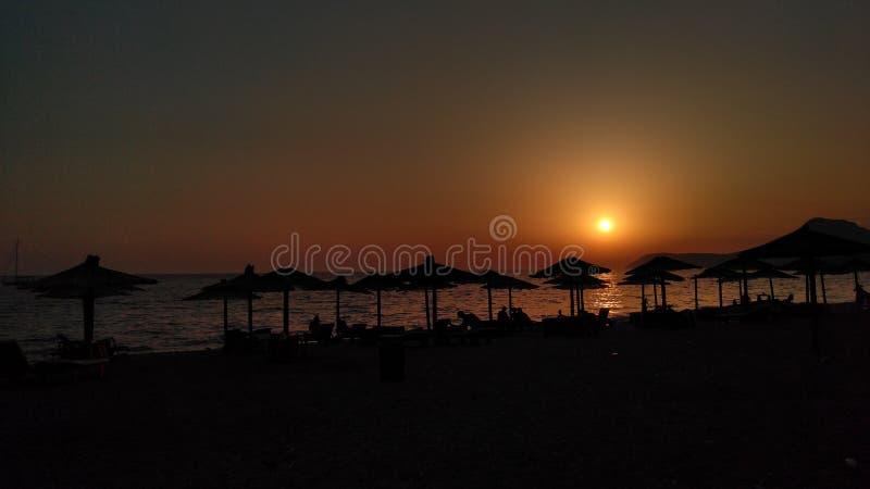 在日落的海滩 免版税库存照片