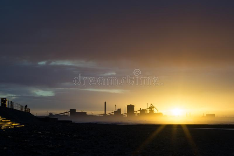 在日落的Redcar海滩 行业背景 图库摄影