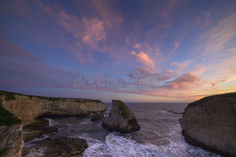 在日落的Sharkfin小海湾 图库摄影