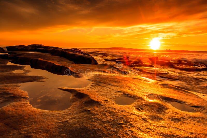 在日落的Windansea海滩 库存图片