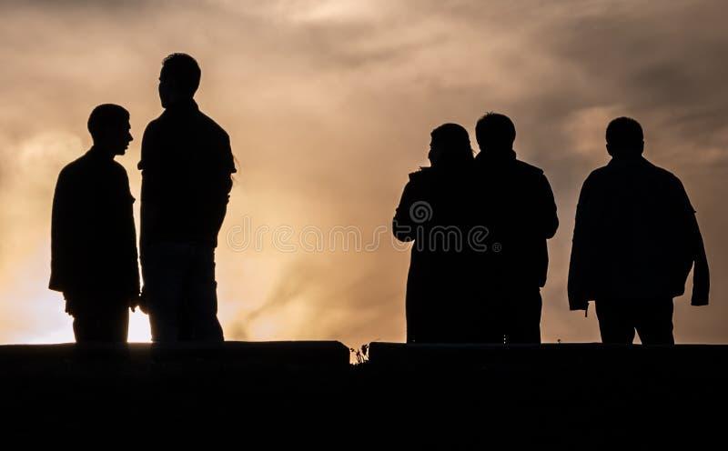在日落背景的剪影 库存图片