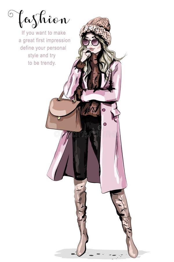 在时髦的编织帽子的时装模特儿 美丽的衣裳塑造妇女年轻人 时髦的逗人喜爱的女孩 美丽的衣裳冬天妇女 皇族释放例证