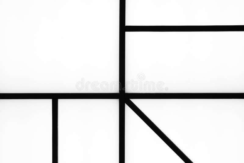 在明亮的白色背景, m的抽象几何黑条纹 库存图片