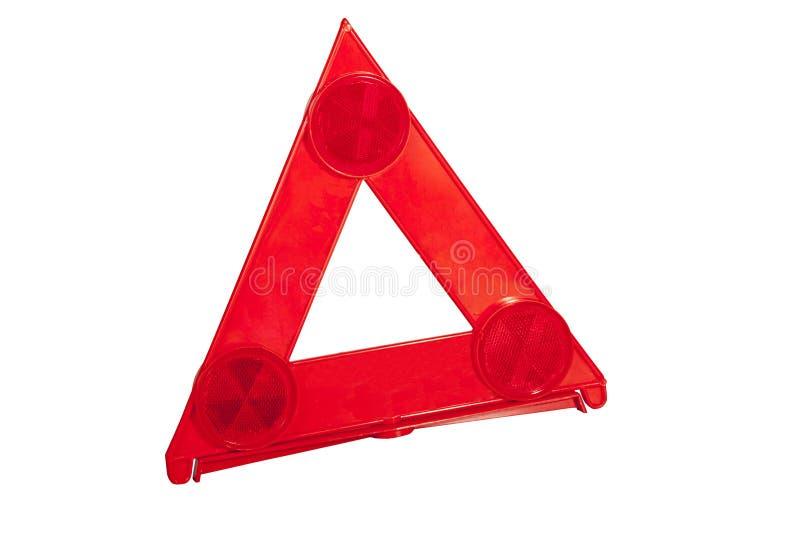 在明亮的红色警告三角的三台反射器 免版税图库摄影