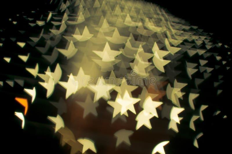 在星的抽象bokeh和透镜火光样式塑造有葡萄酒过滤器被弄脏的背景 免版税库存图片