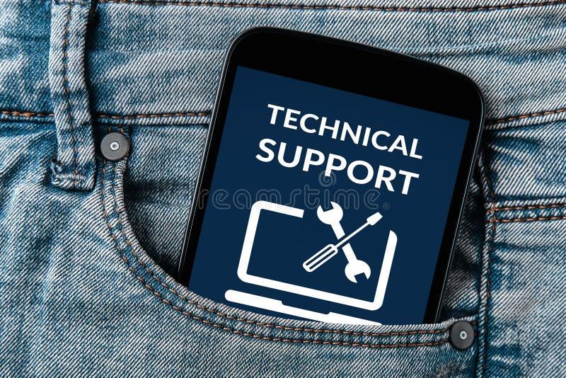 在智能手机屏幕上的技术支持概念在牛仔裤装在口袋里 图库摄影