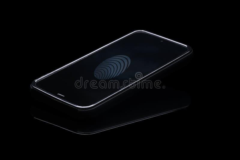 在智能手机的指纹证明 免版税库存照片