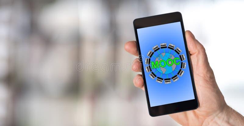 在智能手机的Mooc概念 库存照片