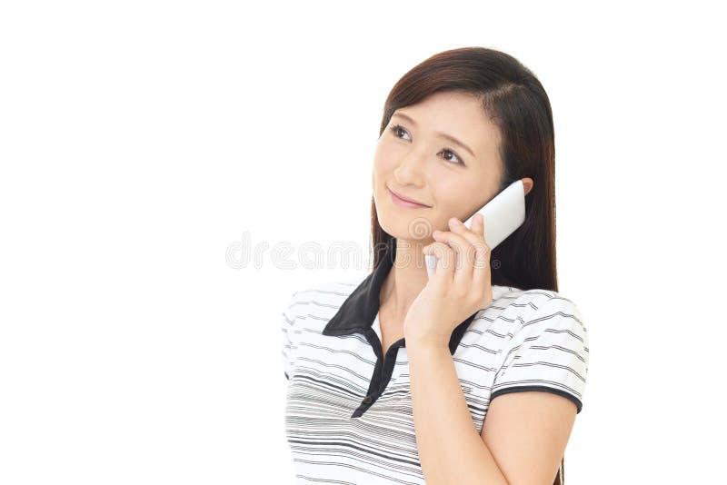 在智能手机谈话的妇女 库存图片