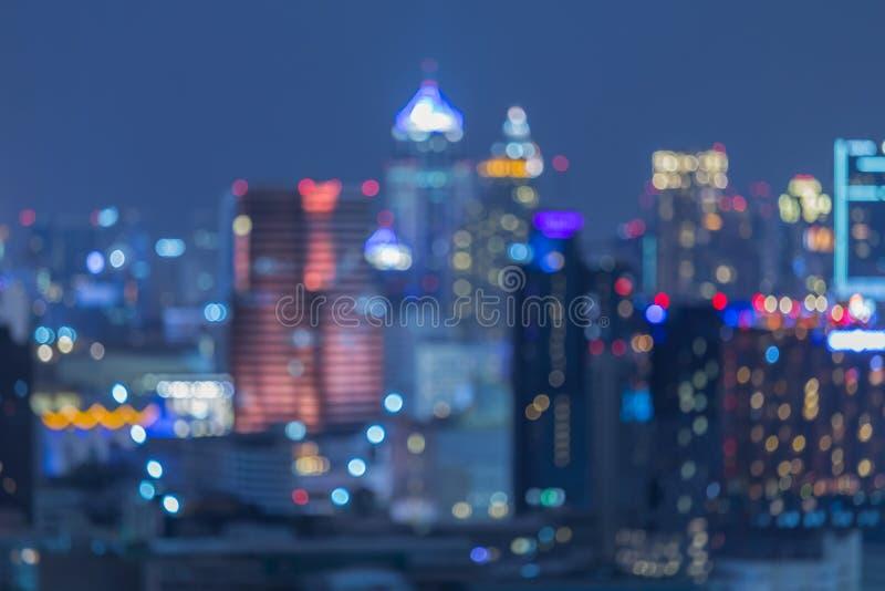在暮色时间,被弄脏的照片bokeh的都市风景 免版税库存图片