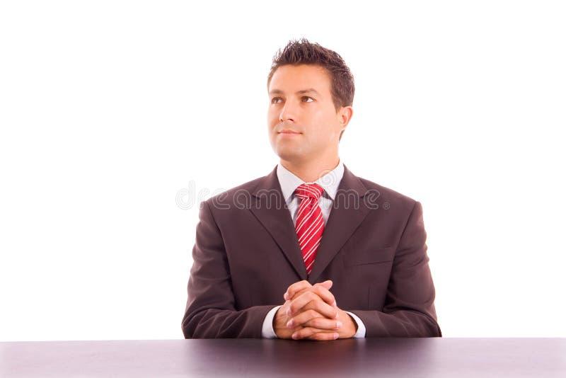 在服务台上的新商人 免版税库存照片