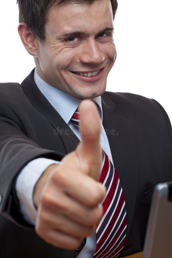 在服务台的新生意人显示赞许 库存图片