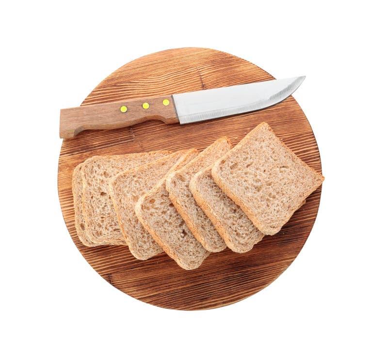 在木切板的切的新鲜面包 免版税库存照片