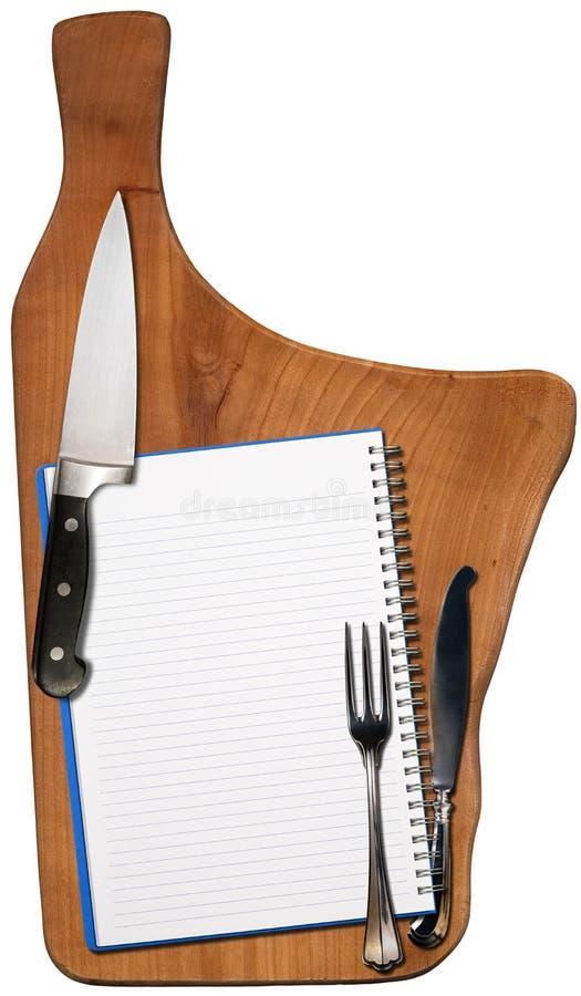 在木切板的空的笔记本 免版税库存照片