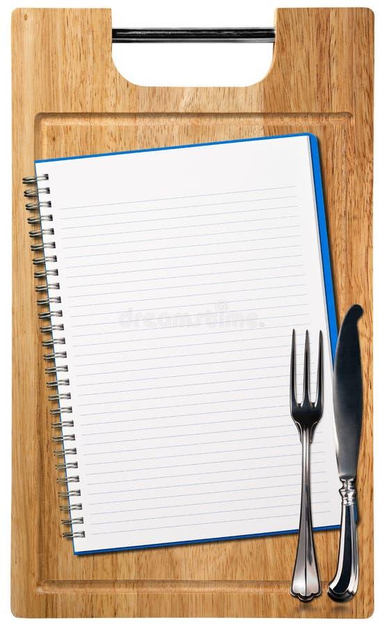 在木切板的空的笔记本 免版税库存图片