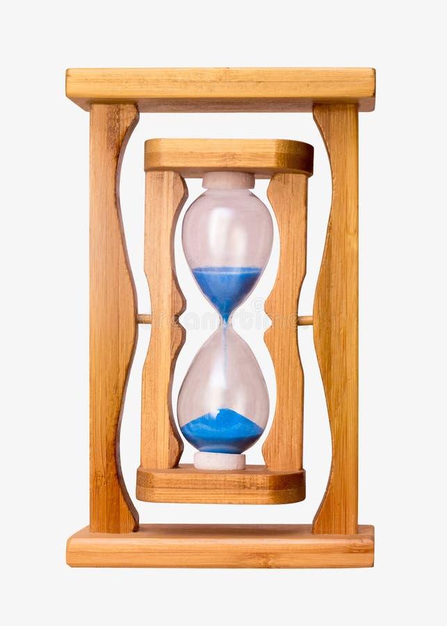 在木制框架的沙子时钟计数了半time_ 免版税库存图片
