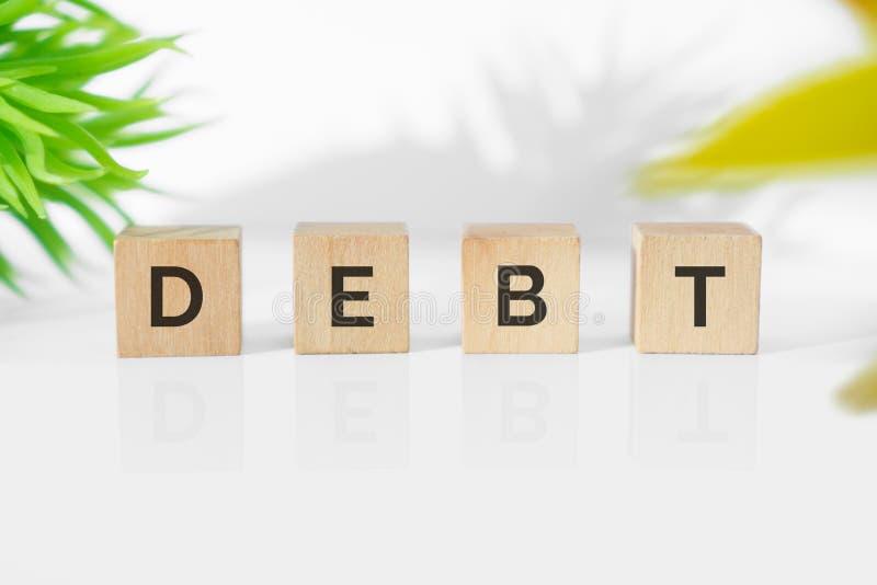 在木刻的债务词 库存图片