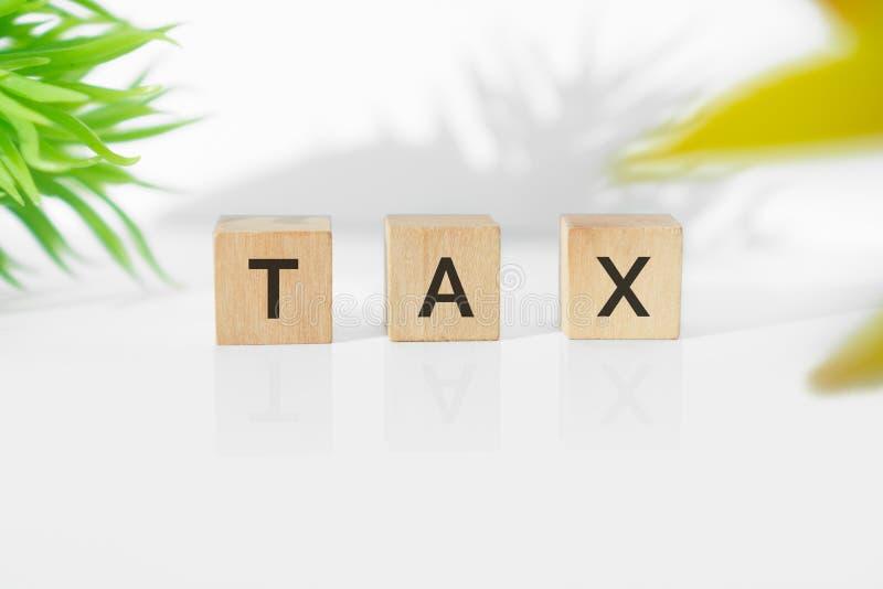 在木刻的税词 免版税图库摄影