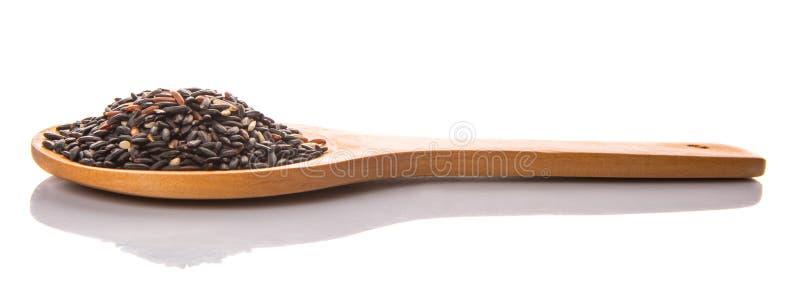 在木匙子v的黑糯米 免版税库存图片