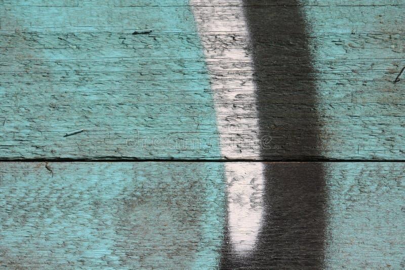 在木墙壁上的街道画 图库摄影