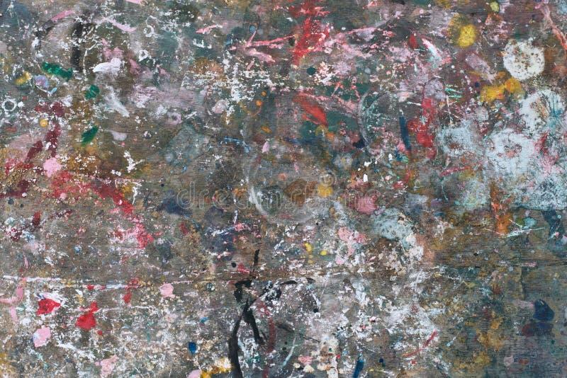 在木头的五颜六色的抽象油漆纹理 免版税图库摄影