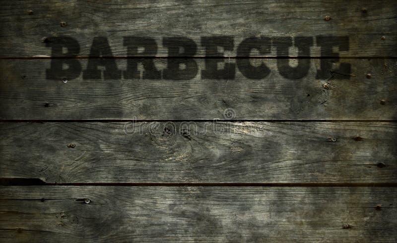在木头的烤肉文本 免版税库存图片